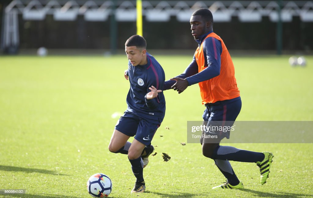 Manchester City's Iancarlo Poveda and Yeboah Amankwah during training at Manchester City Football Academy on October 12, 2017 in Manchester, England.