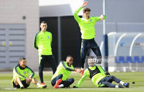 Manchester City's Iancarolo Poveda Phil Foden Raheem Sterling John Stones and Ryhad Mahrez in action during training at Manchester City Football...