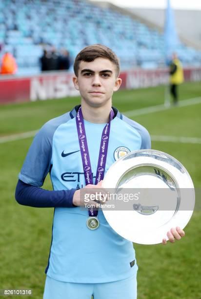 Manchester City's Iker Pozo celebrates winning the U18 Northern Premier League trophy