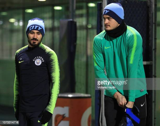 Manchester City's Ilkay Gundogan and Aro Muric react at Manchester City Football Academy on December 14 2018 in Manchester England