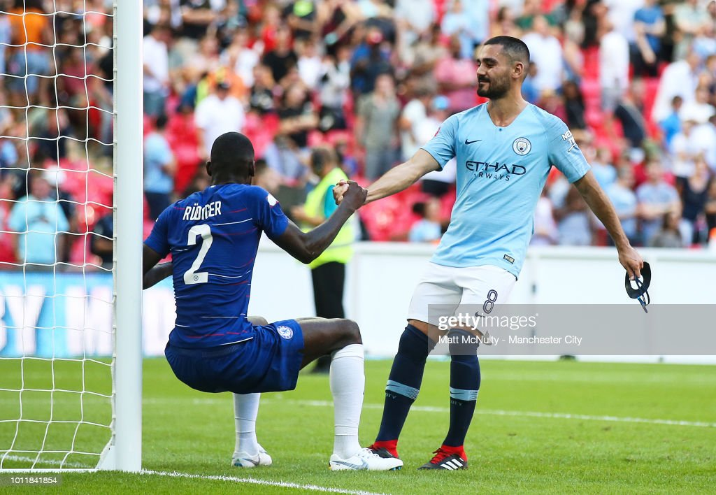 https://media.gettyimages.com/photos/manchester-citys-ilkay-gundogan-helps-up-a-dejected-antonio-rudiger-picture-id1011841854