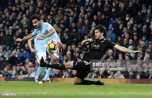 Manchester City's Ilkay Gundogan shoots despite the attentions of Leicester City's Aleksandar Dragovic during the Premier League match between...