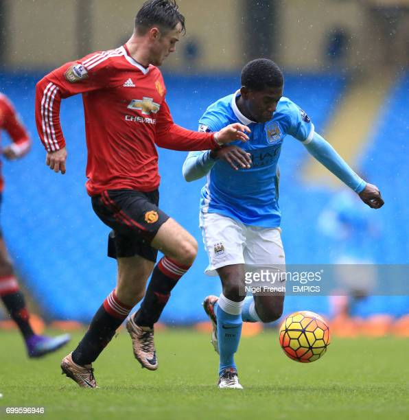 Manchester City's Isaac BuckleyRicketts and Manchester United's Joe Riley battle for the ball