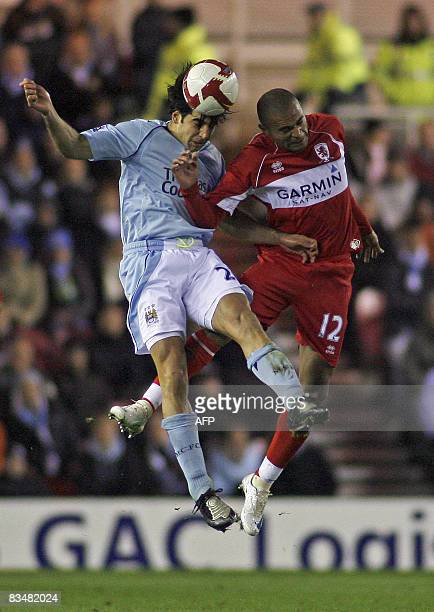 Manchester City's Israeli international Tal Ben Haim vies for the ball with Middlesbrough's Brazilian international Afonso Alves during the Barclays...