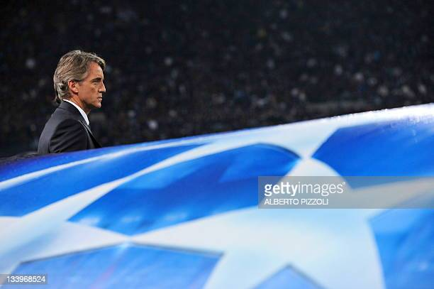 Manchester City's Italian coach Roberto Mancini reacts during the Champions League group A football match Napoli vs Manchester Cit, on November 22,...