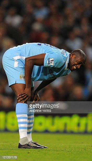 Manchester City's Ivorian defender Yaya Toure reacts during the English Premier League football match between Manchester City and Swansea at The...