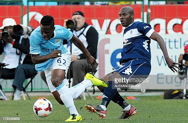 Manchester City's Ivorian midfielder Abdul Razak vies with Supersport United FC's South African defender Innocent Mdledle during a friendly football...