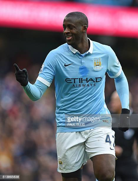 Manchester City's Ivorian midfielder and captain Yaya Toure celebrates scoring his team's first goal during the English Premier League football match...