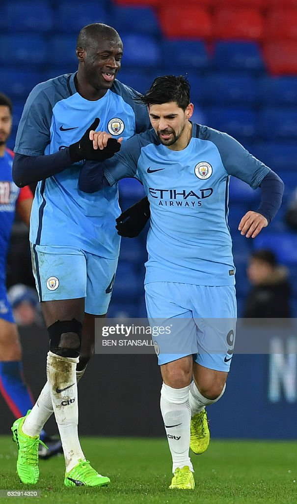 Manchester City's Ivorian midfielder Yaya Toure (L) celebrates scoring their third goal with Manchester City's Spanish midfielder Nolito (R) during the English FA Cup fourth round football match between Crystal Palace and Manchester City at Selhurst Park in south London on January 28, 2017. / AFP / Ben STANSALL / RESTRICTED TO EDITORIAL USE. No use with unauthorized audio, video, data, fixture lists, club/league logos or 'live' services. Online in-match use limited to 75 images, no video emulation. No use in betting, games or single club/league/player publications. /