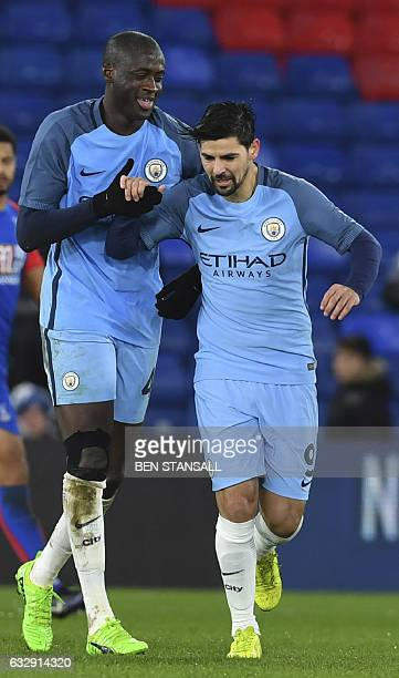 Manchester City's Ivorian midfielder Yaya Toure celebrates scoring their third goal with Manchester City's Spanish midfielder Nolito during the...