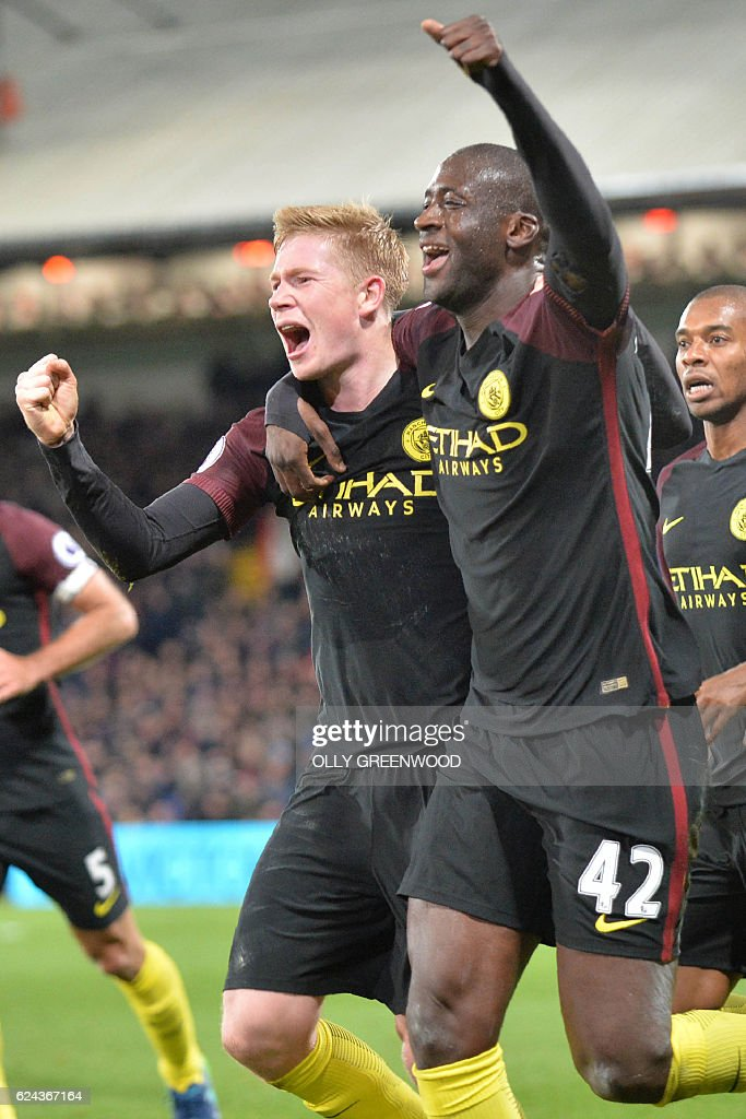 Manchester City's Ivorian midfielder Yaya Toure (R) celebrates with Manchester City's Belgian midfielder Kevin De Bruyne after scoring their second goal during the English Premier League football match between Crystal Palace and Manchester City at Selhurst Park in south London on November 19, 2016. Manchester City won the game 2-1. / AFP / OLLY GREENWOOD / RESTRICTED TO EDITORIAL USE. No use with unauthorized audio, video, data, fixture lists, club/league logos or 'live' services. Online in-match use limited to 75 images, no video emulation. No use in betting, games or single club/league/player publications. /