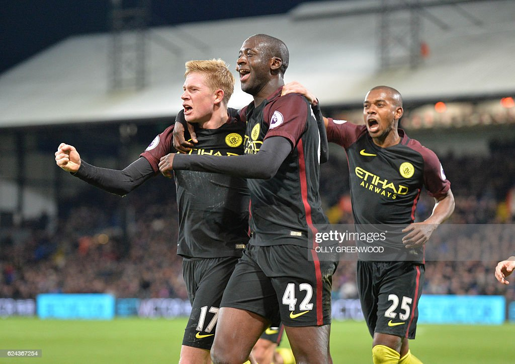 Manchester City's Ivorian midfielder Yaya Toure (C) celebrates with Manchester City's Belgian midfielder Kevin De Bruyne (L) and Manchester City's Brazilian midfielder Fernandinho (R) after scoring their second goal during the English Premier League football match between Crystal Palace and Manchester City at Selhurst Park in south London on November 19, 2016. Manchester City won the game 2-1. / AFP / OLLY GREENWOOD / RESTRICTED TO EDITORIAL USE. No use with unauthorized audio, video, data, fixture lists, club/league logos or 'live' services. Online in-match use limited to 75 images, no video emulation. No use in betting, games or single club/league/player publications. /