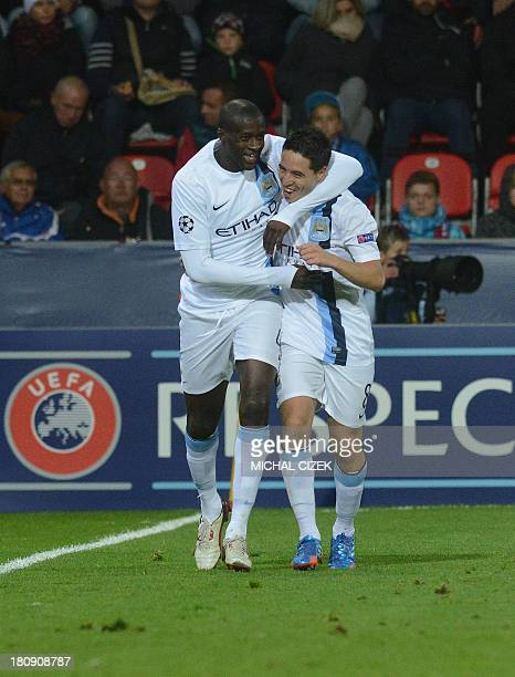 Manchester City's Ivorian midfielder Yaya Toure celebrates with his teammate French midfielder Samir Nasri after he scored during the UEFA Champions...
