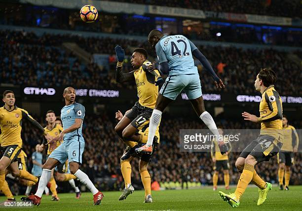 Manchester City's Ivorian midfielder Yaya Toure heads the ball towards goal but fails to score during the English Premier League football match...