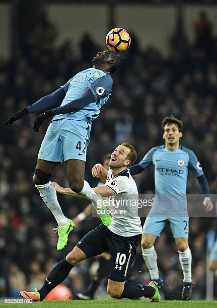 Manchester City's Ivorian midfielder Yaya Toure jumps to win a header during the English Premier League football match between Manchester City and...