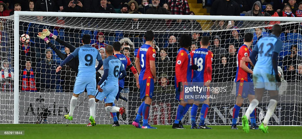 Manchester City's Ivorian midfielder Yaya Toure (R) score their third goal during the English FA Cup fourth round football match between Crystal Palace and Manchester City at Selhurst Park in south London on January 28, 2017. / AFP / Ben STANSALL / RESTRICTED TO EDITORIAL USE. No use with unauthorized audio, video, data, fixture lists, club/league logos or 'live' services. Online in-match use limited to 75 images, no video emulation. No use in betting, games or single club/league/player publications. /