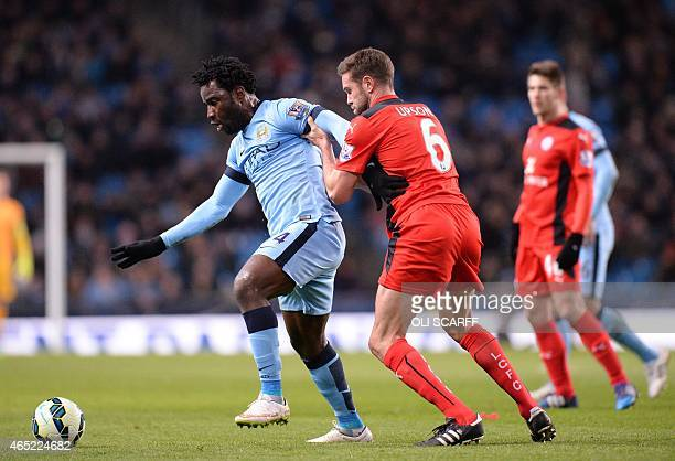 Manchester City's Ivorian striker Wilfried Bony vies with Leicester City's English defender Matthew Upson during the English Premier League football...