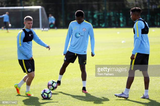 Manchester City's Jacob Davenport Javairo Dilrosun and Demeaco Duhaney in training
