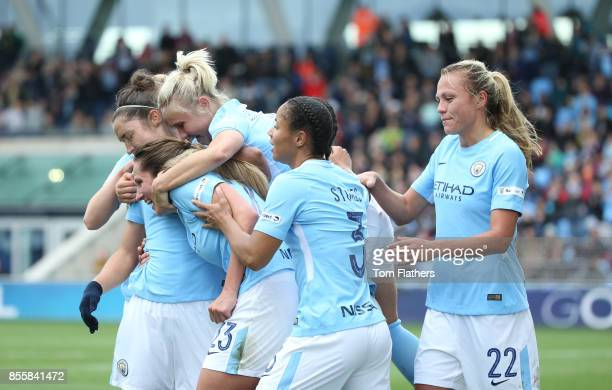 Manchester City's Jane Ross celebrates with her teammates after scoring the opening goal during the WSL 1 match between Manchester City Women and...
