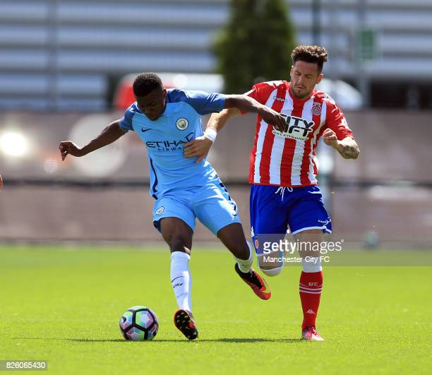 Manchester City's Javairo Dilrosun and Girona's Aday battle for the ball