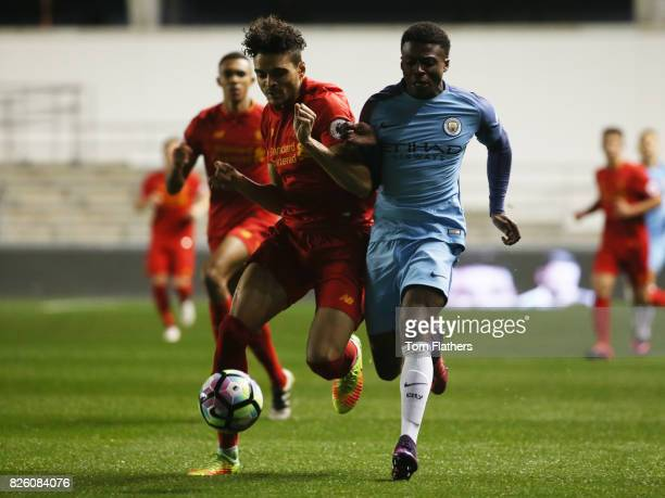 Manchester City's Javairo Dilrosun is challeneged by Liverpool's Tiago Lori