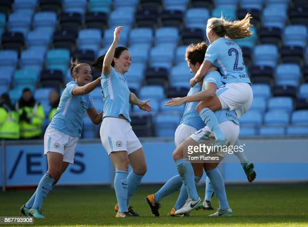 Manchester City's Jennifer Beatie celebrates scoring to make it 21 with her teammates during the WSL 1 match between Manchester City Women and...
