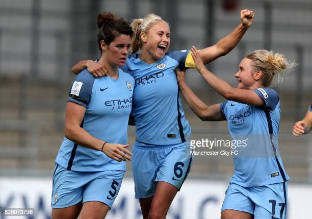 Manchester City's Jennifer Beattie celebrates her goal with Manchester City's Steph Houghton and Manchester City's Izzy Christiansen