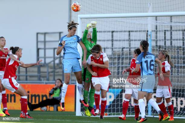 Manchester City's Jill Scott attack the ball as Arsenal Ladies Emma Byrne punches