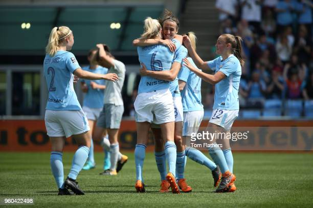 Manchester City's Jill Scott celebrates scoring to make it 10 with her teammates during the WSL match between Manchester City Women and Everton...