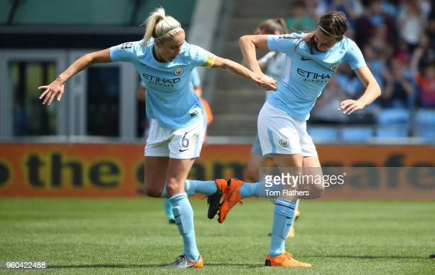Manchester City's Jill Scott celebrates scoring to make it 10 with Steph Houghton during the WSL match between Manchester City Women and Everton...