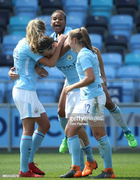 Manchester City's Jill Scott celebrates scoring to make it 30 with her teammates during the WSL match between Manchester City Women and Everton...