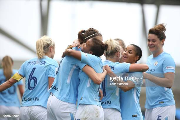 Manchester City's Jill Scott celebrates with teammates after scoring to make it 50 during the WSL 1 match between Manchester City Women and Arsenal...