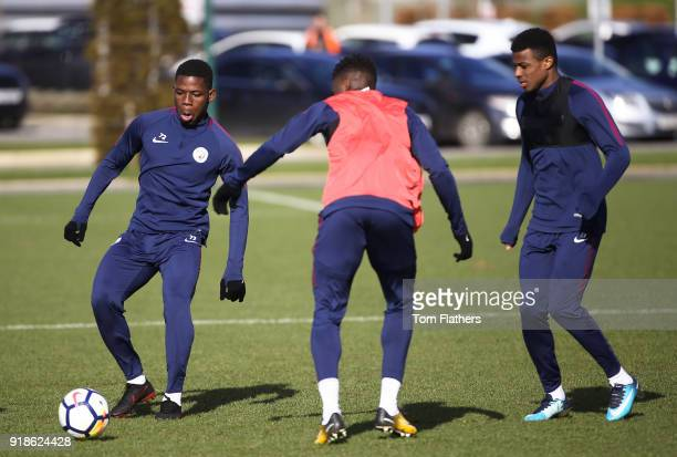 Manchester City's Joel Latibeaudiere Ash Kigbu and Tom DeleBashiru during training at Manchester City Football Academy on February 15 2018 in...
