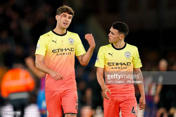 Manchester City's John Stones and Phil Foden after the final whistle of the Premier League match at Selhurst Park London