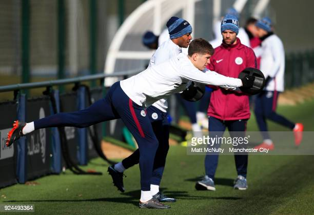 Manchester City's John Stones and Raheem Sterling during the training session at Manchester City Football Academy on February 26 2018 in Manchester...