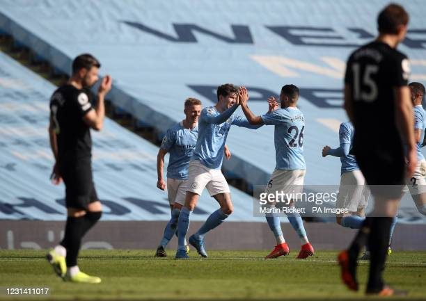 Manchester City's John Stones celebrates scoring their side's second goal of the game during the Premier League match at the Etihad Stadium,...