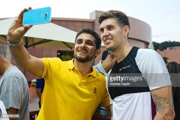 Manchester City's John Stones interacts with fans during the training session on March 16 2018 in Abu Dhabi United Arab Emirates