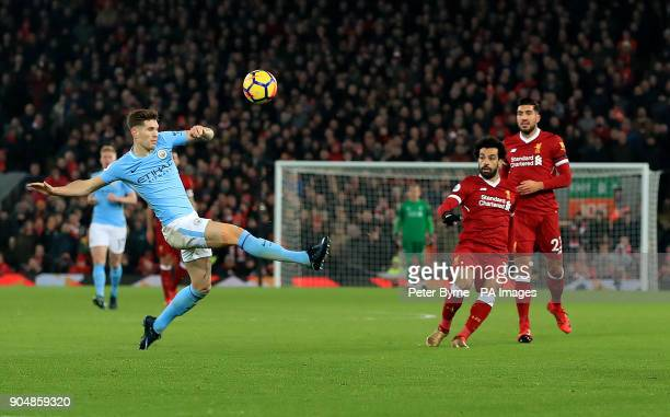 Manchester City's John Stones looks on as Liverpool's Mohamed Salah scores his side's fourth goal of the game during the Premier League match at...