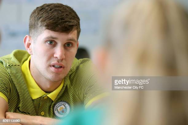 Manchester City's John Stones with school children during a literacy event held at City Football Academy.
