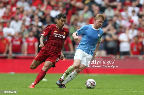 Manchester City's Kevin De Bruyne and Liverpool's Roberto Firmino during the The FA Community Shield match between Liverpool and Manchester City at...