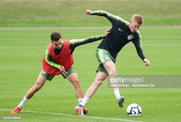 Manchester City's Kevin de Bruyne and Phil Foden during training at Manchester City Football Academy on August 13 2018 in Manchester England