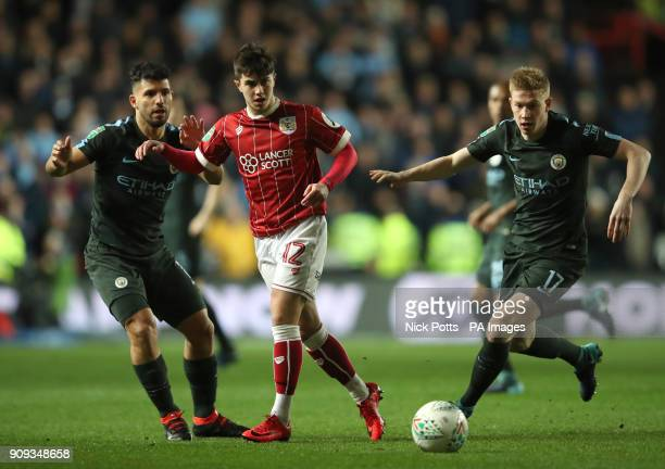 Manchester City's Kevin De Bruyne and Sergio Aguero in action against Bristol City's Liam Walsh during the Carabao Cup semi final second leg match at...
