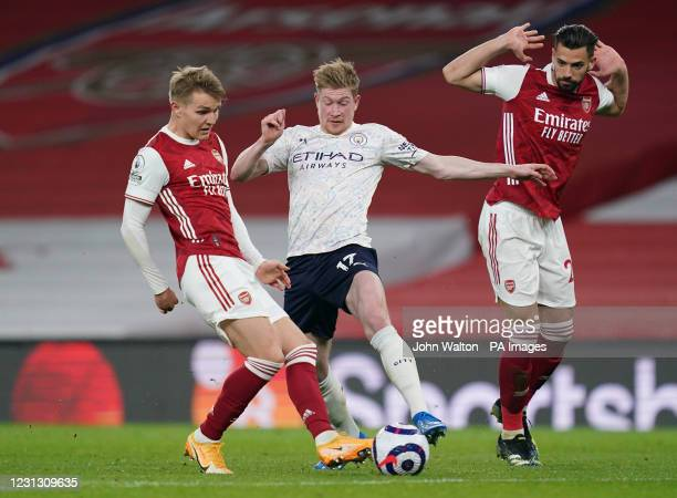 Manchester City's Kevin De Bruyne battles with Arsenal's Martin Odegaard and Pablo Mari during the Premier League match at the Emirates Stadium,...