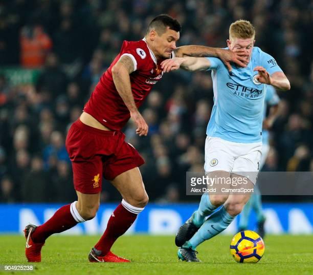 Manchester City's Kevin De Bruyne battles with Liverpool's Dejan Lovren during the Premier League match between Liverpool and Manchester City at...