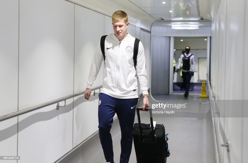Manchester City's Kevin de Bruyne boards the flight at Manchester Airport on March 13, 2018 in Manchester, England.