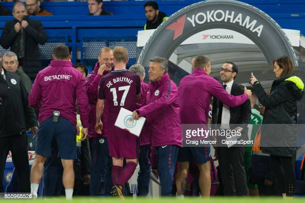 Manchester City's Kevin De Bruyne is congratulated by the Manchester City back room team after the Premier League match between Chelsea and...