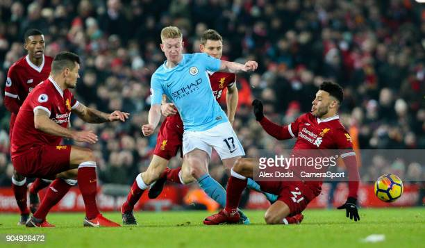 Manchester City's Kevin De Bruyne is tackled by Liverpool's Alex OxladeChamberlain Dejan Lovren and James Milner during the Premier League match...