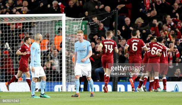Manchester City's Kevin De Bruyne looks dejected as Liverpool celebrate Sadio Mane scoring his side's third goal during the UEFA Champions League...