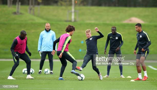 Manchester City's Kevin de Bruyne tackles Philippe Sandler during the training session at Manchester City Football Academy on October 16 2018 in...