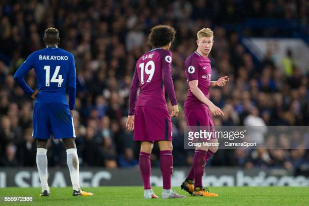 Manchester City's Kevin De Bruyne talks to team mate Leroy Sane during the Premier League match between Chelsea and Manchester City at Stamford...